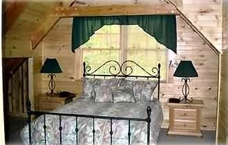 Loft Bedroom with queen wrought iron bed and attached full bathroom