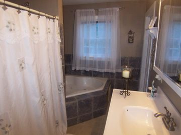 Upstairs bathroom. Garden tub and double shower