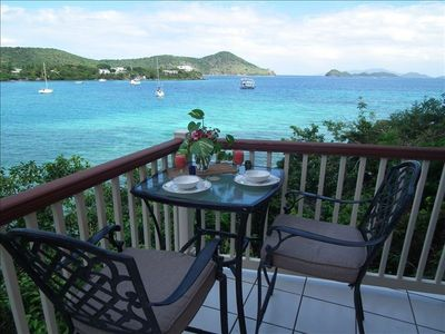 Waterfront dining on the private terrace.