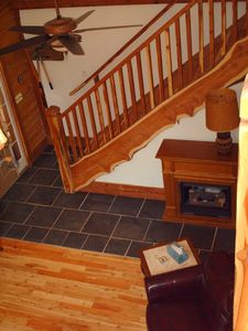 Looking down on stairs and fireplace near front enterance