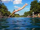 Take a dive into Barton Springs pool.  There is a hike/bike trail at my street!