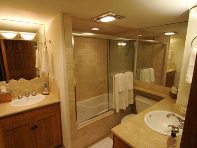 Master Bath with two sinks, jacuzzi tub shower.
