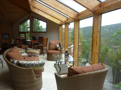 Relax in the sunroom that has  magnificent views!!