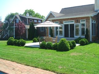 Water Mill house photo - Back yard bluestone patio showing detached garage with apartment above