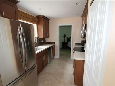 Stainless kitchen with LG appliances and full size LG Washer/Dryer