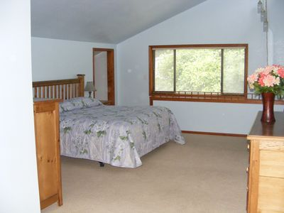 Another view of master bedroom with comfy king-size bed.