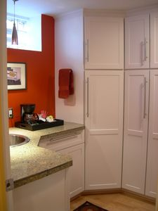 Some of the ample cabinetry in the bathroom
