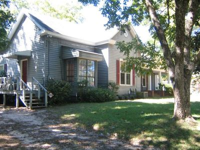 Side 1 of the house has 2 bedrooms ,1 bath, fireplace and a large front porch