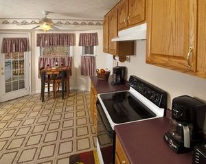 Luray lodge photo - Kitchen: stocked with pots, pans, plates, silverware, glasses, etc.
