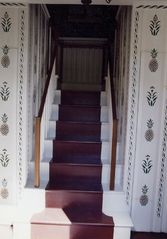 Wellfleet house photo - Front hall and staircase with hand-stenciled wall detail