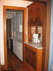 Marble top nook with washer/dryer below. View to kitchen.