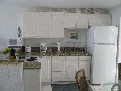 Fully equipped kitchen with new granite tops.