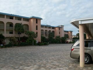 Sanibel Island condo photo - Pavers and flower gardens dot the landscape. Elevators between buildings.