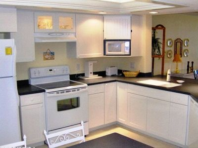 Bright Kitchen with Fridge, Stove, Dishwasher, Microwave & Appliances.