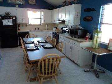 Fully equipped kitchen, new appliances, seating for 8, highchair, booster chair