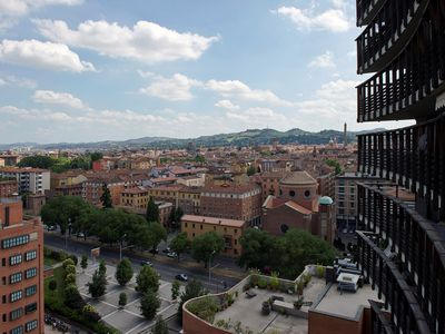 The view from the terrace - the towers, the hills, the roofs of Bologna.