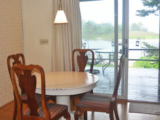East Quogue house photo - Dining area (there are 6 chairs) and view of back porch and bay.