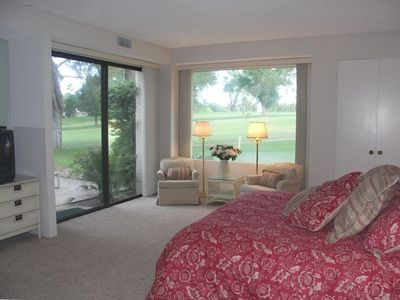 Master Bedroom with glass doors to back patio and views of the golf course