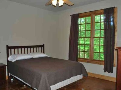 Greers Ferry Lake cabin rental - Bedroom with Queen bed and view of river.