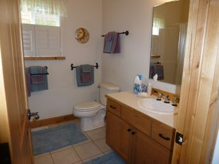 Bozeman house photo - Guest Bath separates Queen, Twin bedrooms for privacy; has shower and tub combo