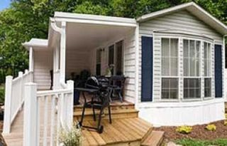 Flat Rock cottage photo - Beautiful covered porch for relaxing or reading a good book. Ramp for wheelchair