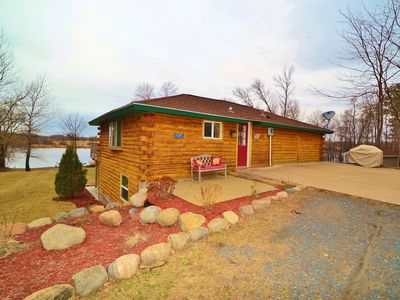 4 bedroom log home on  private quaint lake and 12 acres. 1 hour north of Mpls.