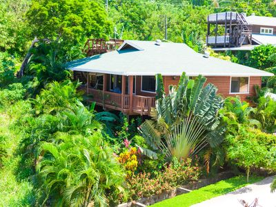 Exterior view of Mango House tucked hillside just off West End Beach