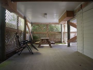 Carport under home- outdoor shower; well lit; great area for kids to play