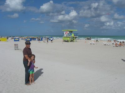 My daughter and i on a walk on the beach after a lunch on the strip