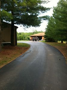 Paved driveway leading to the house. Lots of parking.
