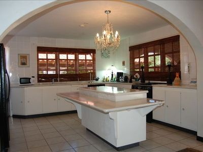 Kitchen with marble counter tops, refrigerator stove, mircowave coffee maker etc