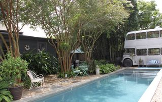 New Orleans studio photo - Shared 50 foot mineral system lap pool. Guest patio to the left of the bus.