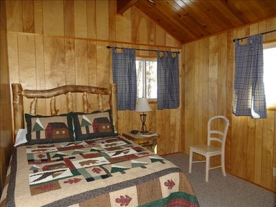 Queen Bedroom- vaulted ceilings, rustic log bed, beautiful views of the forest
