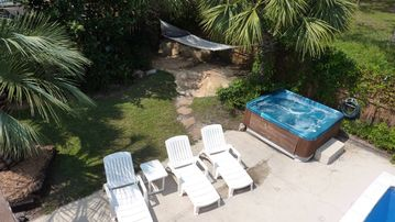 WOW! Everything is here for you! Pool, Spa, Sundeck, Hammock, Swing, Game Room +