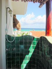 The rooftop shower has an unforgettable ocean view. - Playa del Carmen villa vacation rental photo