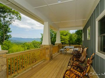 Asheville house rental - Rocking chairs on a huge covered proch with view and dining.
