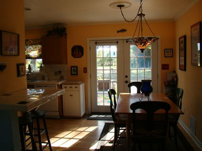Sun room off of kitchen provides one of two dining areas