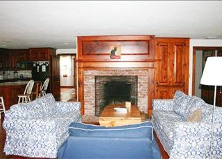 Brewster house photo - There is plenty of room to gather by the fireplace in the Living room.