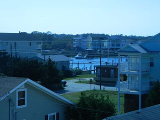 Carolina Beach condo photo - From the front deck you can watch the sun set over the marina each evening.