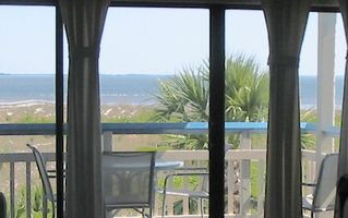 Harbor Island condo photo - Living area sliding doors open to ocean view deck.