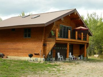 Ely cabin rental - Hand built log guest cabin above garage