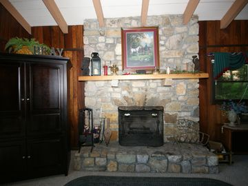 Upstairs rock fireplace that is large and great for roasting marshmellows