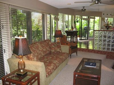 Living room with view toward dining room and kitchen