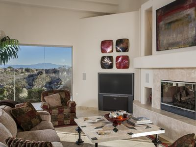 Gorgeous living area with fireplace and breathtaking views