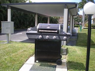 Court of Palms condo photo - BBQ grill area