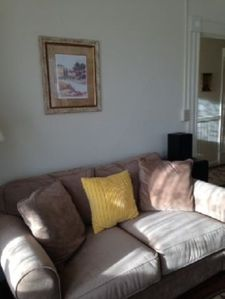 small couch in front seating area
