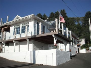 Depoe Bay house rental - VIEW FROM THE OCEAN SIDE.(LOOKING EAST!) GLASS RAILINGS,BLT IN TABLE&AND BENCH