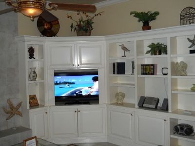 Oversized TV with built-in book cases.