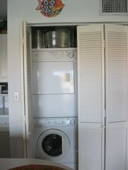 Washer & Dryer along with detergent, iron and ironing board - Bimini condo vacation rental photo
