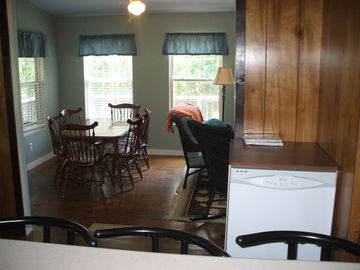 Dining area from kitchen sink. Portable dishwasher hooks to kitchen faucet.